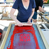 Beverly: Sarah Smith, a professor at Montserrat, makes some screen prints for Arts Fest Beverly.  photo by Mark Teiwes / Salem News