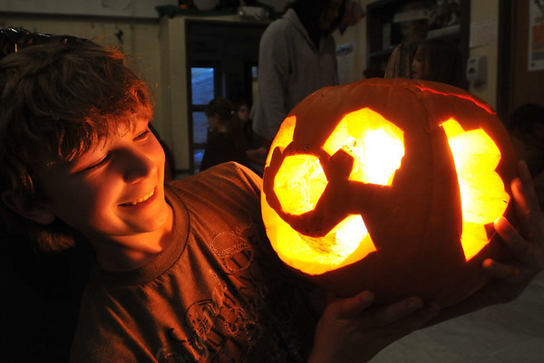 Middleton: Connor Mochi, 12,  shows off his clown face pumpkin he carved.  He will also be a clown for Halloween.   photo by Mark Teiwes / Salem News