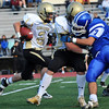 Peabody: Bishop Fenwick's Nick Bona runs through a hole created by his offensive line.   photo by Mark Teiwes / Salem News