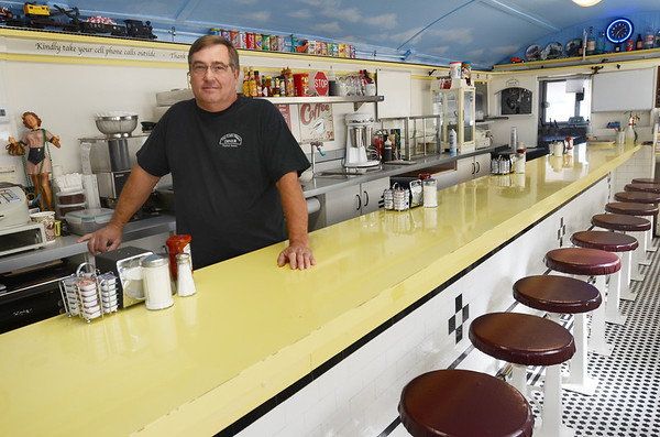 Peabody: Jim Miles stands in the Little Depot Diner which he owns with his wife Judy.  The diner recently closed.  photo by Mark Teiwes / Salem News