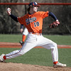 Salem: Salem State's starting pitcher Matt Kerr winds up to release a pitch.  photo by Mark Teiwes / Salem News