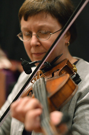 Salem: Jennifer Strom plays the fiddle with the Salem Country Orchestra during the  Salem First Saturday Contra Dance at Tabernacle Church. photo by Mark Teiwes / Salem News