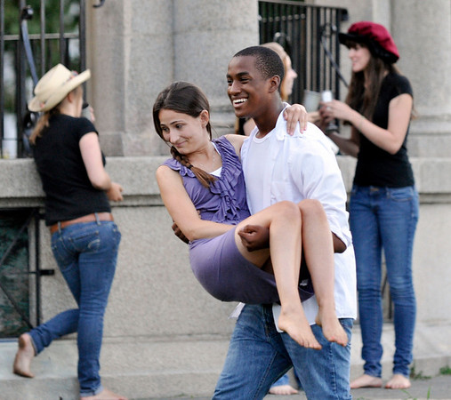 Salem:  Jabari Tovar of Salem plays Othello sweeping into his arms Emilie Soghomonian of Marblehead playing the part of Desdemona with the Rebel Shakespeare Co.  photo by Mark Teiwes / Salem News
