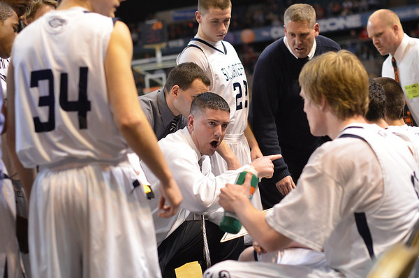 Worcester: St. John's Prep head coach Sean Connolly talks strategy with his team midway through the championship game. photo by Mark Teiwes / Salem News