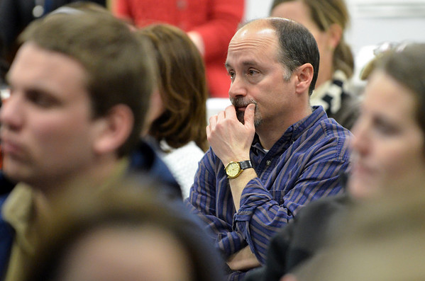 Wenham: Dave Askwyth, father of a son and daughter in the school system, listens to a presentation at the School Committee meeting.  photo by Mark Teiwes / Salem News