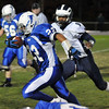 Danvers: Danvers' Nick Valles, left, carries the ball closely followed by Swampscott's Jermaine Kelly on a drive that led to a touchdown photo by Mark Teiwes / Salem News