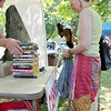 Ipswich: Isabel Marshall of Ipswich purchases a stack of books at the Friends of the Ipswich Library book sale.  She was hoping to find a Harry Potter book but still came away with some classics. photo by Mark Teiwes / Salem News