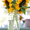 Hamilton:  Sun flowers from the farm were the table centerpiece for the North Shore Women in Business clambake.  photo by Mark Teiwes / Salem News