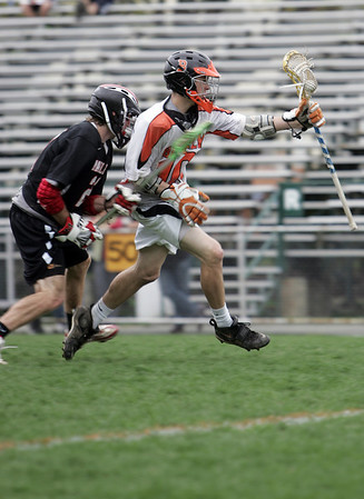 Beverly: Beverly's Dave Rollins, left, attacks the goal defended by Marblehead's Hunter Whitmore.  photo by Mark Teiwes