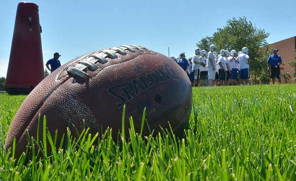 Danvers: Players run through drills on the first day of practice for the Danvers High School football team.   photo by Mark Teiwes /  Salem News