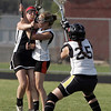 Ipswich: Despite tight defense from Ipswich's Grace Gardner, center,  Marblehead's Meggie Collins, manages to score past goal keeper Cassandra Balzer, right.   photo by Mark Teiwes / Salem News