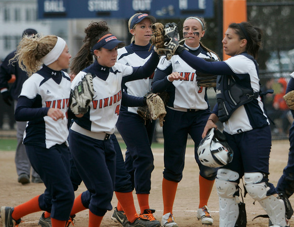 Salem:  Salem State softball team comes together after a successful defensive inning in the field.  The Vikings could not get offensive momentum and lost 0-4 to Plymouth State   photo by Mark Teiwes / Salem News