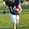 Hamilton:  Hunter Smith, 12, sprints upfield at a Hamilton-Wenham Youth Football practice.   photo by Mark Teiwes / Salem News