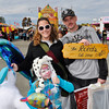 Topsfield: Tara and Jon Reed with daughter Alexis, 7, are on the midway with armfuls of fair loot.