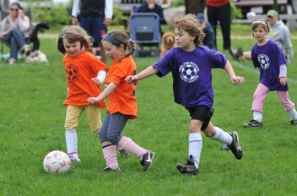 Hamilton:   Orange soccer team dribble away from the Purple Lilac team.  photo by Mark Teiwes / Salem News