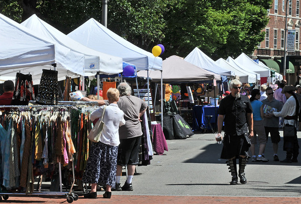 Salem: The street was filled with sidewalk vendors for the Essex Street Fair run by the Salem Chamber of Commerce.  photo by Mark Teiwes / Salem News