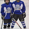 Salem: Michael Eisner of Salem, 10, left, and Victor Kratik of Swampscott, 10, practice with the Salem Swampscott Blades hockey at Salem State University's Rockett Arena   photo by Mark Teiwes / Salem News