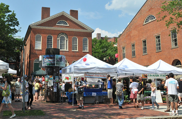 Salem:  Town Hall Square was full of food and customers for the opening day of the Salem Farmers' Market.  photo by Mark Teiwes / Salem News