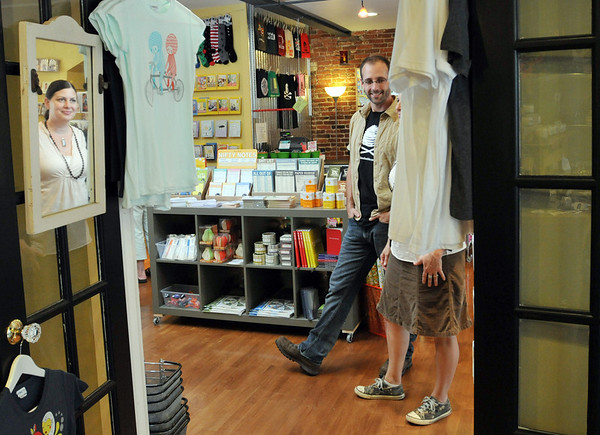 Salem: Husband and wife Jamie Metsch and Kate Leavy have two Front Street businesses side by side, Roost and Beehive.  There is a doorway between the two businesses so they can hang out during the day.  photo by Mark Teiwes / Salem News