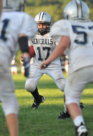 Hamilton:  Pierson Tocci, 10, carries the ball in an offensive play at a Hamilton-Wenham Youth Football practice.   photo by Mark Teiwes / Salem News