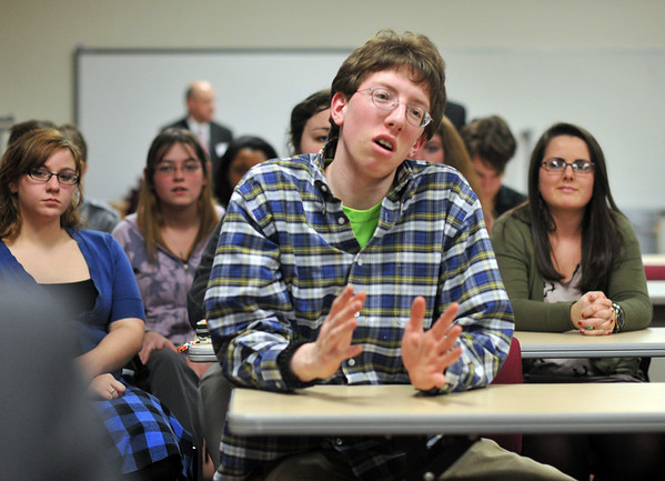 Salem: Samuel Teatum, a senior at the Salem Academy Charter School asks Newt Gingrich at question about US engery policy at a press conference.   photo by Mark Teiwes / Salem News