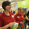 Peabody: Lisa Starkey, left, passed out gift cards to the first 300 customers while Noreen Winstanley gave out carnations.   photo by Mark Teiwes / Salem News