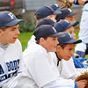Peabody:  The Higgins Middle School team watches as their teammate is up to bat.  photo by Mark Teiwes / Salem News