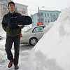 Beverly: Papa Gino's delivery man Steve Gendall, 22, of Beverly, delivers a pizza on Bennett Streeet.  He worked 11am-8pm as the snow, sleet and rain fell yesterday.  He said it is tough on days like this, but he usually gets better tips.  photo by Mark Teiwes / Salem News