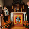 "Salem.  Brother Tom, right, pastoral associate of St. Thomas the Apostle Parish, stands next to the an icon of ""Our Mother of Sorrows"" which commemorates the 9/11 tragedy.  Sally Hayes, left, and Eloise Garbriel are part of the luturgical committee.  The painting will be featured at a special 9-11 Mass on Saturday.   photo by Mark Teiwes / Salem News"