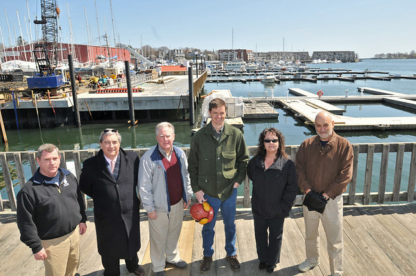 Beverly: From left, Dan McPherson, harbor master; Wes Slate, ward 2 city councilor; Paul Earl, chairman of the harbor management;  Mike Collins, commissioner of public services and engineering, Tina Cassidy, city planner; and Don Neuman, harbor authority, stand amongst the $2.5 million waterfront renovation projects .  photo by Mark Teiwes / Salem News