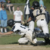 Peabody: Peabody High School's Stephen Girolamo, left, dodges the tag of Malden Catholic catcher Connor Bryant to safely score on a steal at home.  photo by Mark Teiwes / Salem News