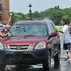 Salem:   Members of the Salem High School music department wash cars to raise money.  The next car wash will be held August 28th 9am-3pm.  photo by Mark Teiwes / Salem News