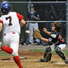 Beverly: Peabody West catcher Bobby Caproni covers the base in time to make the out at home plate tagging out Swampscott's Christian Liorente. Mark Teiwes / Salem News