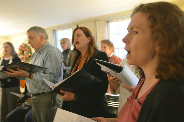 Danvers: George Pomfret, left, Jennifer Revill, and Julia Elliot practice an arrangement with Essex Harmony. group  photo by Mark Teiwes / Salem News