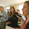 Danvers: George Pomfret, left, Jennifer Revill, and Julia Elliot practice an arrangement with Essex Harmony. group  photo by Mark Teiwes / Salem News