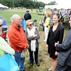 Hamilton:  Senator Scott Brown, right, and his daughter Ayla greet spectators Trish Moseley, left, Jeff Hooper and Perk Moseley, all three from Hamilton, at the Putnam Boston Jumper Classic.  photo by Mark Teiwes / Salem News