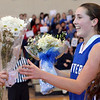 Boxford:  Danvers captain Kellie Macdonald recieves flowers after making a shot late in the second half against Masconomet to score 1000 points.  photo by Mark Teiwes  / Salem News