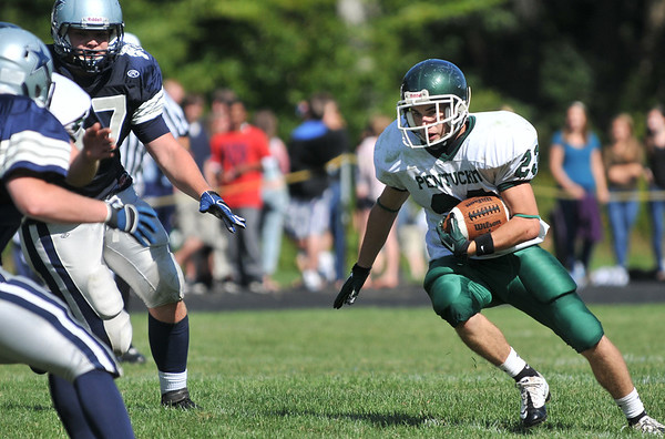 Hamilton: Pentucket running back Nick D'Agostino carries the ball for a run against Hamilton-Wenham.  photo by Mark Teiwes  / Salem News