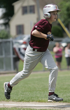 Danvers:  Danvers National Little League player Ted Vaillancourt sprints to first base in a District 15 game against Groveland. photo by Mark Teiwes / Salem News