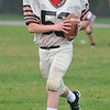 Beverly:  Joey Marchetti, 14, runs with the football. photo by Mark Teiwes /  Salem News