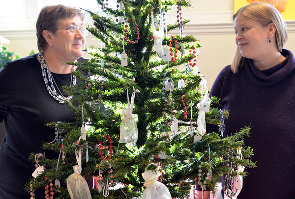 "Danvers: Lynne Duffill, left, and her daughter Mercy Duffill helped organize the Maple Street Congregational Church Advent Fair which includes crafts from around the world including ""Beads for Life"" made by Ugandan women.  photo by Mark Teiwes / Salem News"