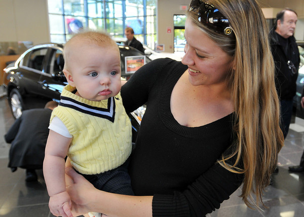 Danvers: Eryn Haugen, business development manager at Kelly Infiniti brought her 6-month-old son Sawyer to a party introducing the new G25X model.    photo by Mark Teiwes / Salem News