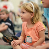 "Hamilton:  Brooke Sargent, 4, of Hamilton listens to a reading of the book ""Pete's a Pizza"" during Rhythm and Rhyme story time at the Hamilton-Wenham Public Library.  photo by Mark Teiwes /  Salem News"