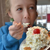 "Danvers: Nicolette Townsend, 11, of Beverly digs into a waffle breakfast sundae at the Cherry Farm Creamery ""Ice Cream for Breakfast"" event benefiting a children's room at the Peabody Institute Library in Danvers.  photo by Mark Teiwes  / Salem News"
