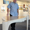 Salem: Anthony Ferrigno, stands next to a piece of furniture he made from zebra veneer and ash for the show which is guest-curated by Janey Winchell, the Sarah Fraser Robbins Director of the Art & Nature Center at the Peabody Essex Museum.   photo by Mark Teiwes / Salem News