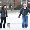 Salem:  Sisters Gail Murdoch of Peabody, left, and Caorl Costello of Amesbury skate on Salem Common's ice skating rink. photo by Mark Teiwes / Salem News