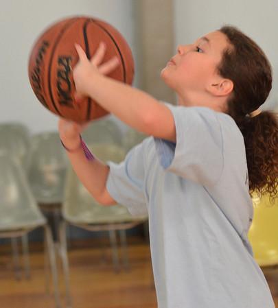Beverly: Julia Pitman, 9, makes a shot. photo by Mark Teiwes  / Salem News