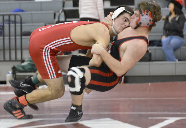 Topsfield:   Masconomet's Aydan Strachan, left, drives Salem's Jon Lausier to the ground.  Strachan won on a pin in the 171 pound division. photo by Mark Teiwes  / Salem News