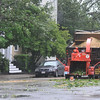 Salem:  Salem public service workers respond to limbs fallen into the streets during Tropical Storm Irene.   photo by Mark Teiwes / Salem News
