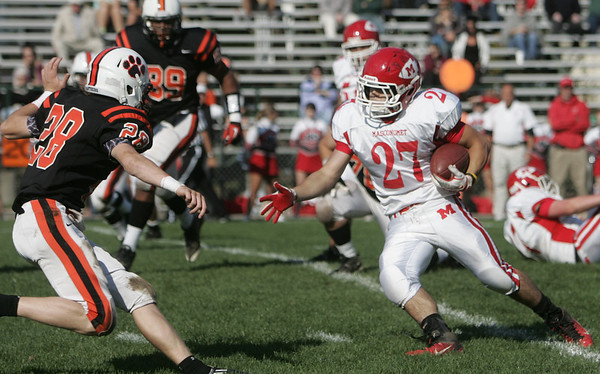 Beverly:  Masco's Mike Tivinis, right, drives covered by Beverly's Kenny Pierce. photo by Mark Teiwes / Salem News